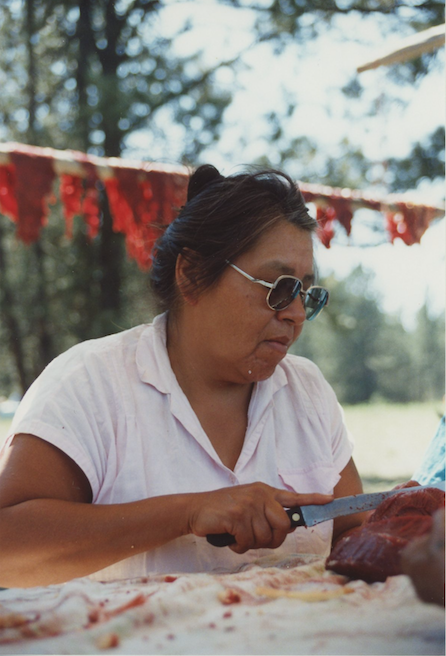 Ernestine Two Moons, Cheyenne; cutting buffalo meat, MT 1992. Photo: Lisa Gruwell